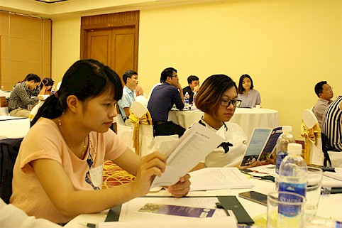 Participants review materials explaining the social, ecological and legislative significance of applying sustainable and fair trade frameworks as part of their corporate social responsibility.