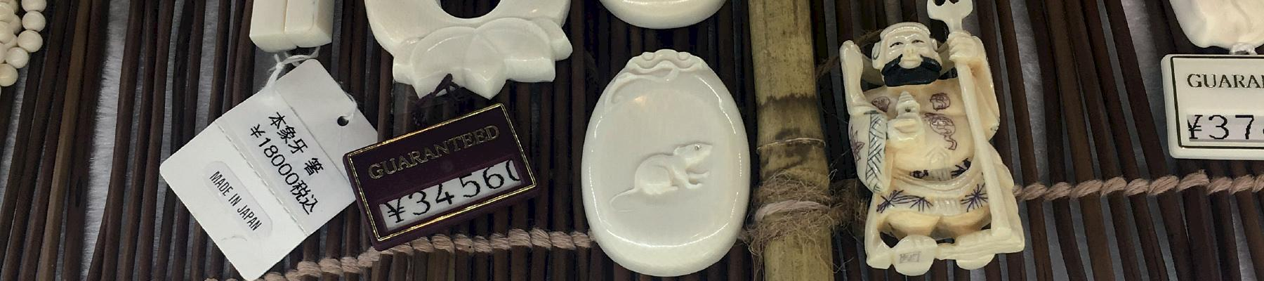 "Display of ivory items at a shop in Tokyo's tourist areas. A sticker promotes ""made in Japan"" shown also in Chinese and Korean © TRAFFIC"